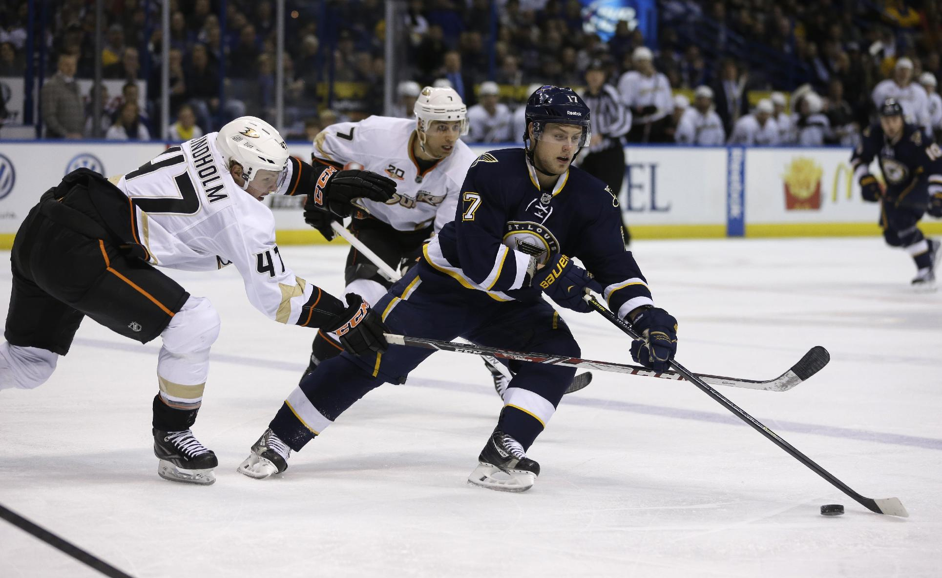 St. Louis Blues' Vladimir Sobotka, right, of the Czech Republic, controls the puck as Anaheim Ducks' Hampus Lindholm, left, of Sweden, and Andrew Cogliano, center, give chase during the second period of an NHL hockey game on Saturday, Jan. 18, 2014, in St. Louis