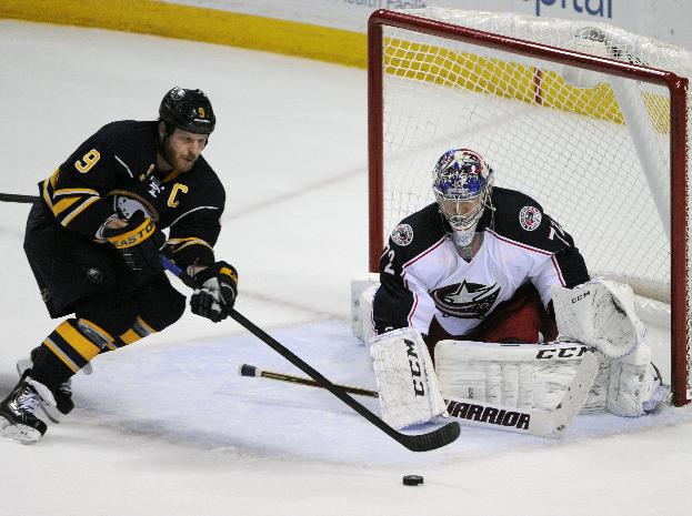 Buffalo Sabres center Steve Ott (9) moves the puck in front of Columbus Blue Jackets goaltender Sergei Bobrovsky (72), of Russia, during the overtime session of an NHL hockey game in Buffalo, N.Y., Saturday, Jan.18, 2014.  The Blue Jackets won 4-3 in a shootout