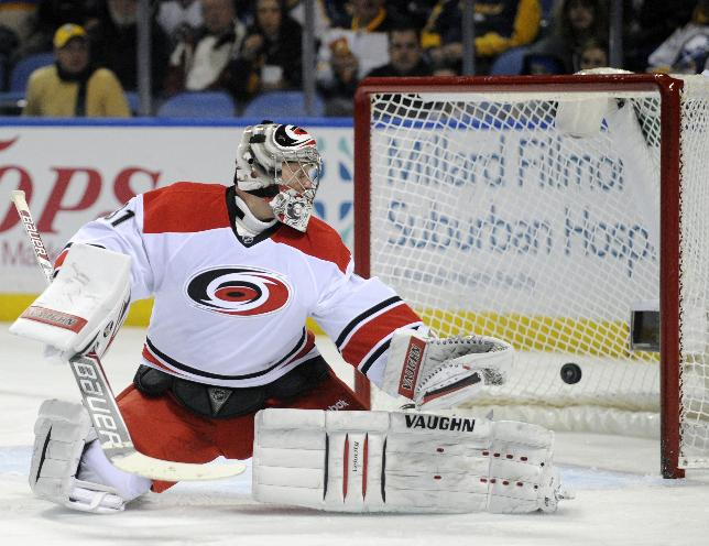 Carolina Hurricanes goaltender Anton Khudobin, of Russia, looks back after he is beaten for a goal by Buffalo Sabres'  Cody Hodgson during the first period of an NHL hockey game in Buffalo, N.Y., Thursday, Jan. 23, 2014
