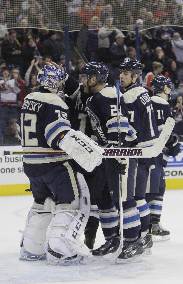 Columbus Blue Jackets goalie Sergei Bobrovsky, left, of Russia, is congratulated after beating the Philadelphia Flyers in an NHL hockey game Thursday, Jan. 23, 2014, in Columbus, Ohio. The Blue Jackets extended their franchise record winning streak to eight games with a 5-2 win over the Flyers