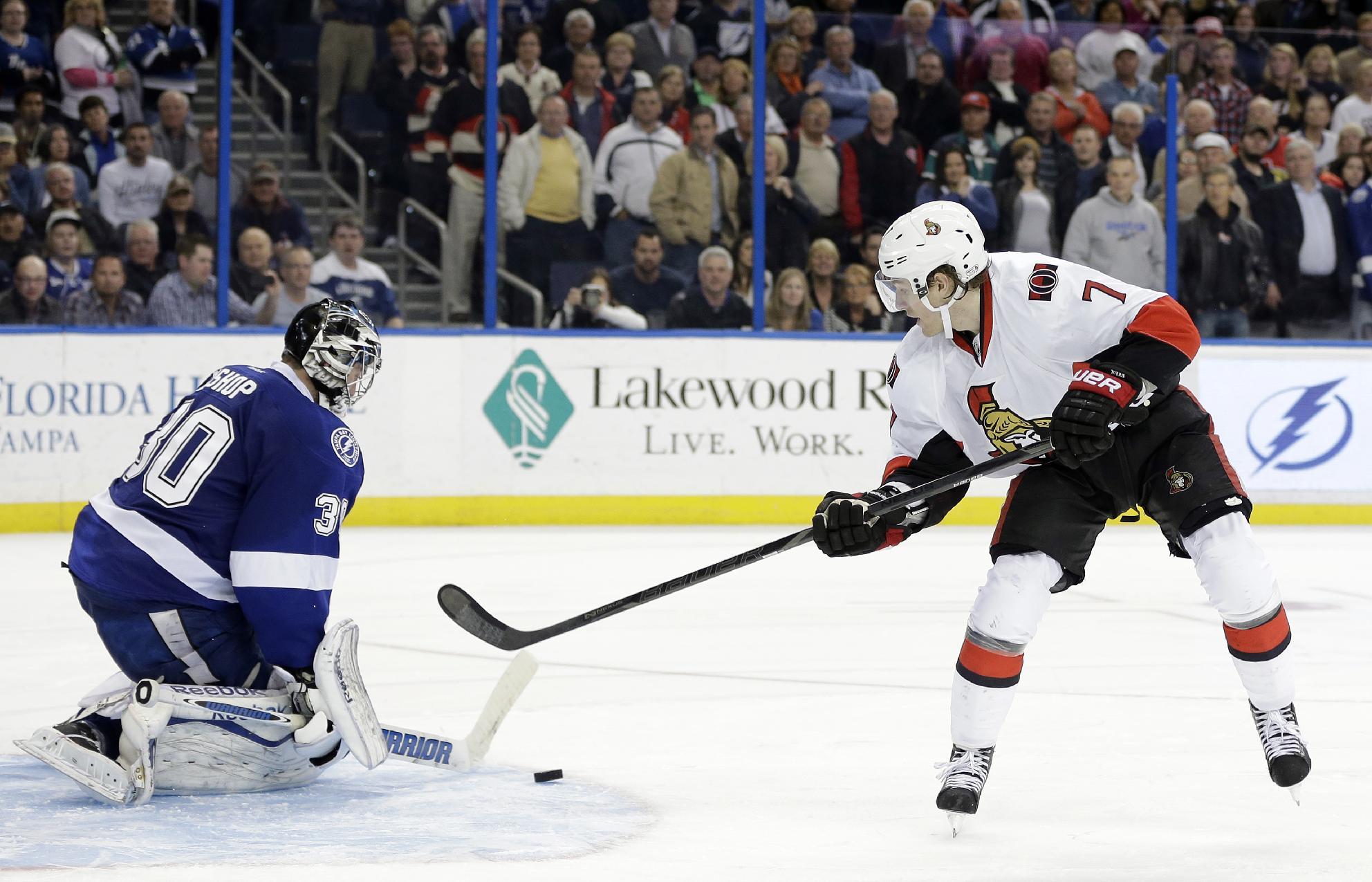 Tampa Bay Lightning goalie Ben Bishop (30) stops Ottawa Senators center Kyle Turris (7) during a shootout in an NHL hockey game Thursday, Jan. 23, 2014, in Tampa, Fla. The Lightning won the game 4-3