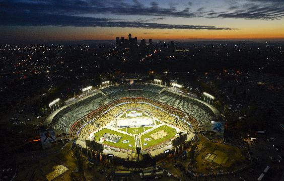 Fans arrive before the start of an NHL outdoor hockey game at Dodger Stadium between the Los Angeles Kings and the Anaheim Ducks in Los Angeles, Saturday, Jan. 25, 2014