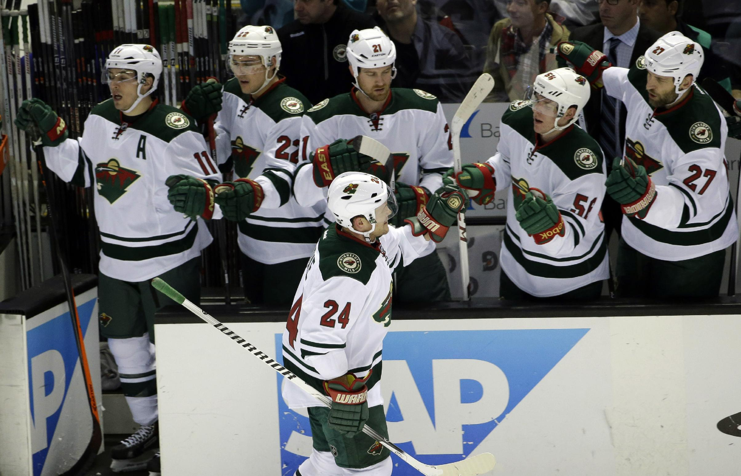 Minnesota Wild's Matt Cooke (24) celebrates his goal with teammates during the first period of an NHL hockey game against the San Jose Sharks on Saturday, Jan. 25, 2014, in San Jose, Calif