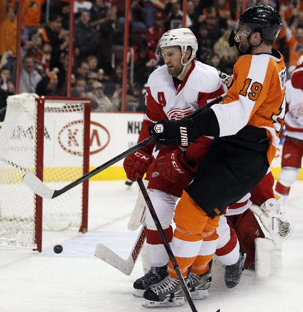 The gola scored by Philadelphia Flyers' Scott Hartnell, right, rolls back out of the net as Detroit Red Wings' Niklas Kronwall, left, skates past during the second period of an NHL hockey game, Tuesday, Jan. 28, 2014, in Philadelphia