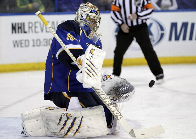 St. Louis Blues goalie Jaroslav Halak (41) makes a save in the first period against the New Jersey Devils of an NHL hockey game, Tuesday, Jan. 28, 2014 in St. Louis