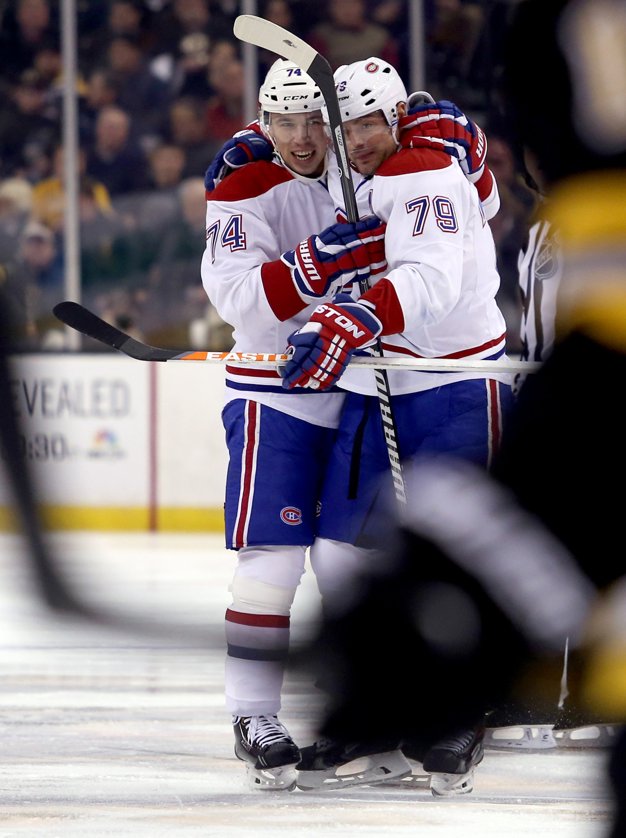 Montreal Canadiens defenseman Alexei Emelin (74) is congratulated by teammate Andrei Markov (79) after scoring a goal during the first period of an NHL hockey game against the Boston Bruins, Thursday, Jan. 30, 2014, in Boston. Markov assisted on the play