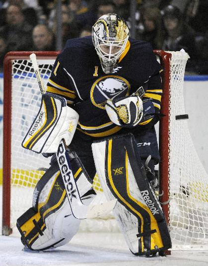 Buffalo Sabres goaltender Jhonas Enroth, of Sweden, eyes the puck on an incoming shot from the Edmonton Oilers during the second period of an NHL hockey game in Buffalo, N.Y., Monday, Feb 3, 2014