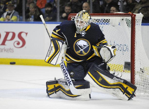Buffalo Sabres goaltender Jhonas Enroth, of Sweden, gets beat for a goal from Edmonton Oilers' Justin Schultz during the second period of an NHL hockey game in Buffalo, N.Y., Monday, Feb 3, 2014