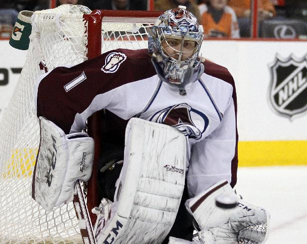 Colorado Avalanche goalie Semyon Varlamov watches the puck heading to his glove by a shot from Philadelphia Flyers' Brayden Schenn during the second period of an NHL hockey game, Thursday, Feb. 6, 2014, in Philadelphia