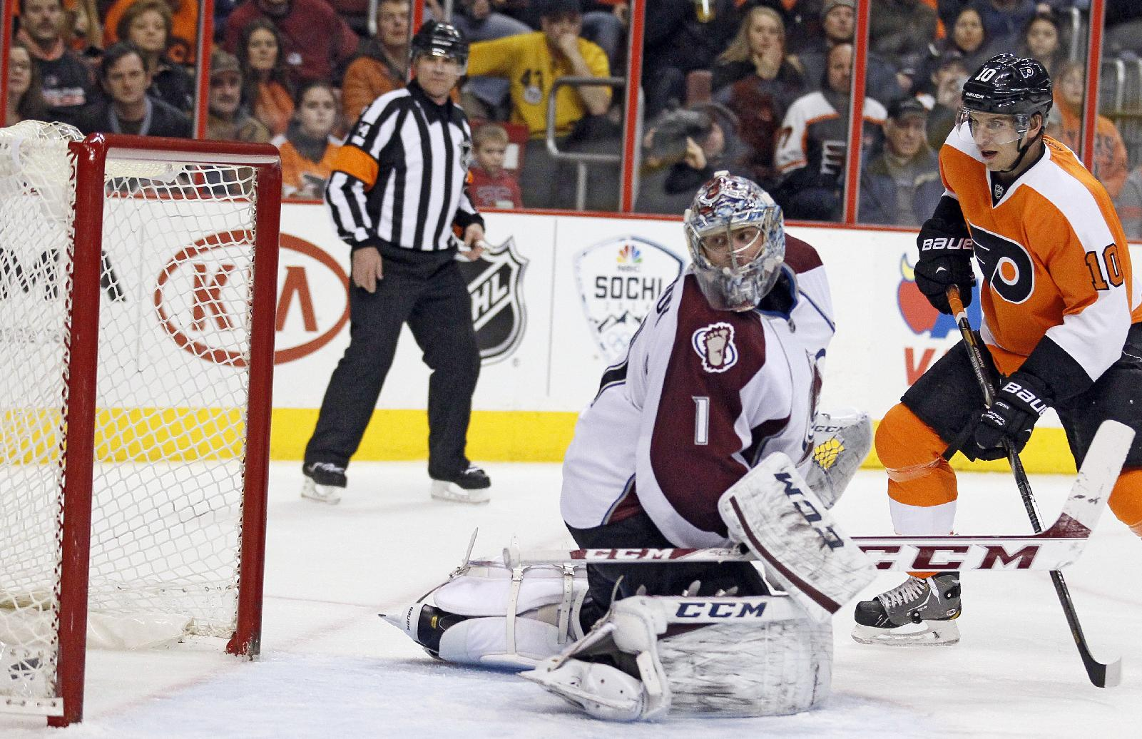 Colorado Avalanche goalie Semyon Varlamov looks back at the puck in the net, lower left, shot by Philadelphia Flyers' Mark Streit, not pictured, as Brayden Schenn, right, looks on during the second period of an NHL hockey game, Thursday, Feb. 6, 2014, in Philadelphia