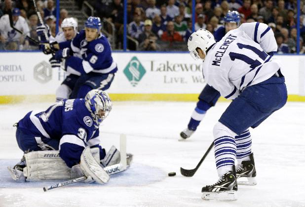 Toronto Maple Leafs center Jay McClement (11) slides the puck past Tampa Bay Lightning goalie Cedrick Desjardins (31) for a goal during the third period of an NHL hockey game Thursday, Feb. 6, 2014, in Tampa, Fla. The Maple Leafs won the game 4-1