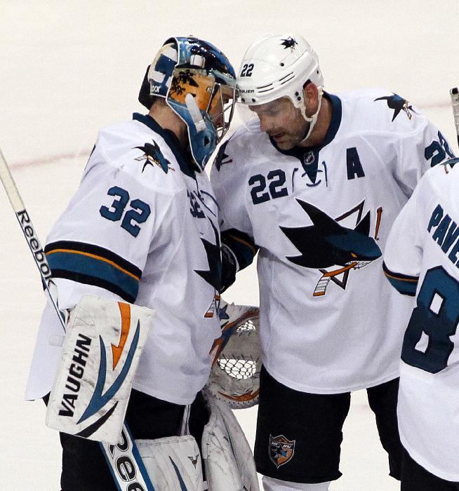 San Jose Sharks' Alex Stalock, left, and Dan Boyle, right, celebrate at the end of an NHL hockey game against the Philadelphia Flyers, Thursday, Feb. 27, 2014. The Sharks won 7-3