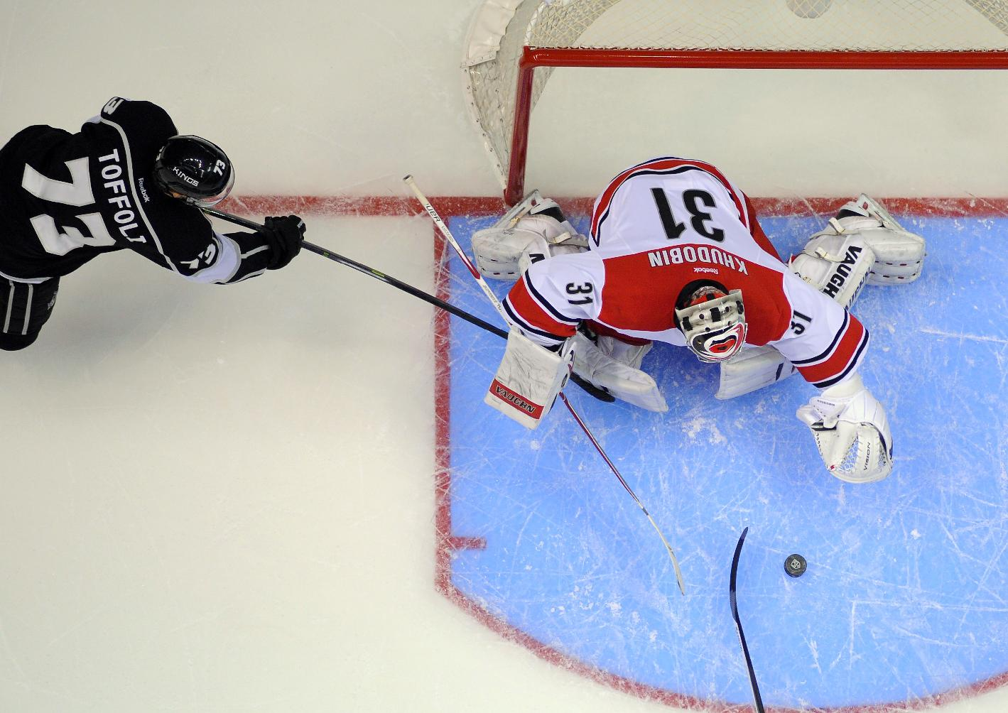 Los Angeles Kings center Tyler Toffoli, left, tries to get a shot in on Carolina Hurricanes goalie Anton Khudobin, of Kazakhstan, during the first period of an NHL hockey game, Saturday, March 1, 2014, in Los Angeles