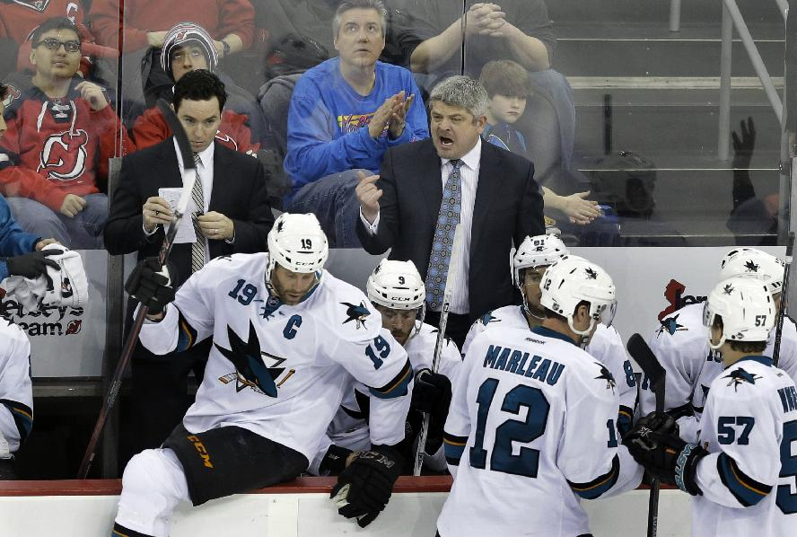 San Jose Sharks head coach Todd McLellan shouts to his players in the third period of an NHL hockey game against the New Jersey Devils, Sunday, March. 2, 2014, in Newark, N.J. The Sharks won 4-2