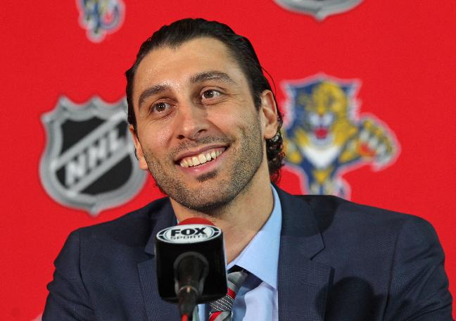 Florida Panthers goalie Roberto Luongo smiles during a news conference Wednesday, March 5, 2014, in Sunrise, Fla. After nearly eight years apart, Luongo was the centerpiece of a four-player trade between Florida and the Vancouver Canucks on Tuesday. The Panthers sent goalie Jacob Markstrom--once considered their future in net--and forward Shawn Matthias to the Canucks for Luongo and forward Steven Anthony