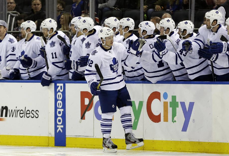 Toronto Maple Leafs' Tyler Bozak (42) celebrates with teammates after scoring on a penalty shot during the second period of an NHL hockey game against the New York Rangers on Wednesday, March 5, 2014, in New York