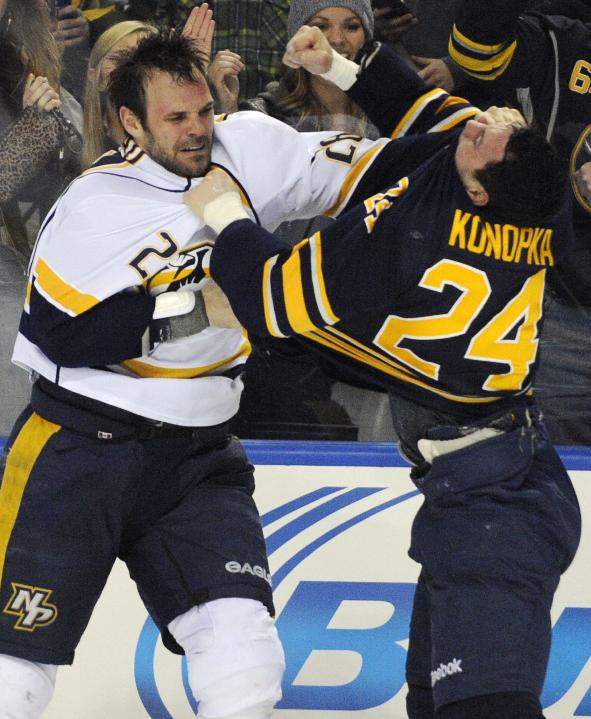 Nashville Predators' Paul Gaustad (28) pushes the jersey into the face of Buffalo Sabres' Zenon Konopka (24) as he throws a punch during a fight in the second period of an NHL hockey game in Buffalo, N.Y., Tuesday, March 11, 2014. Nashville won 4-1