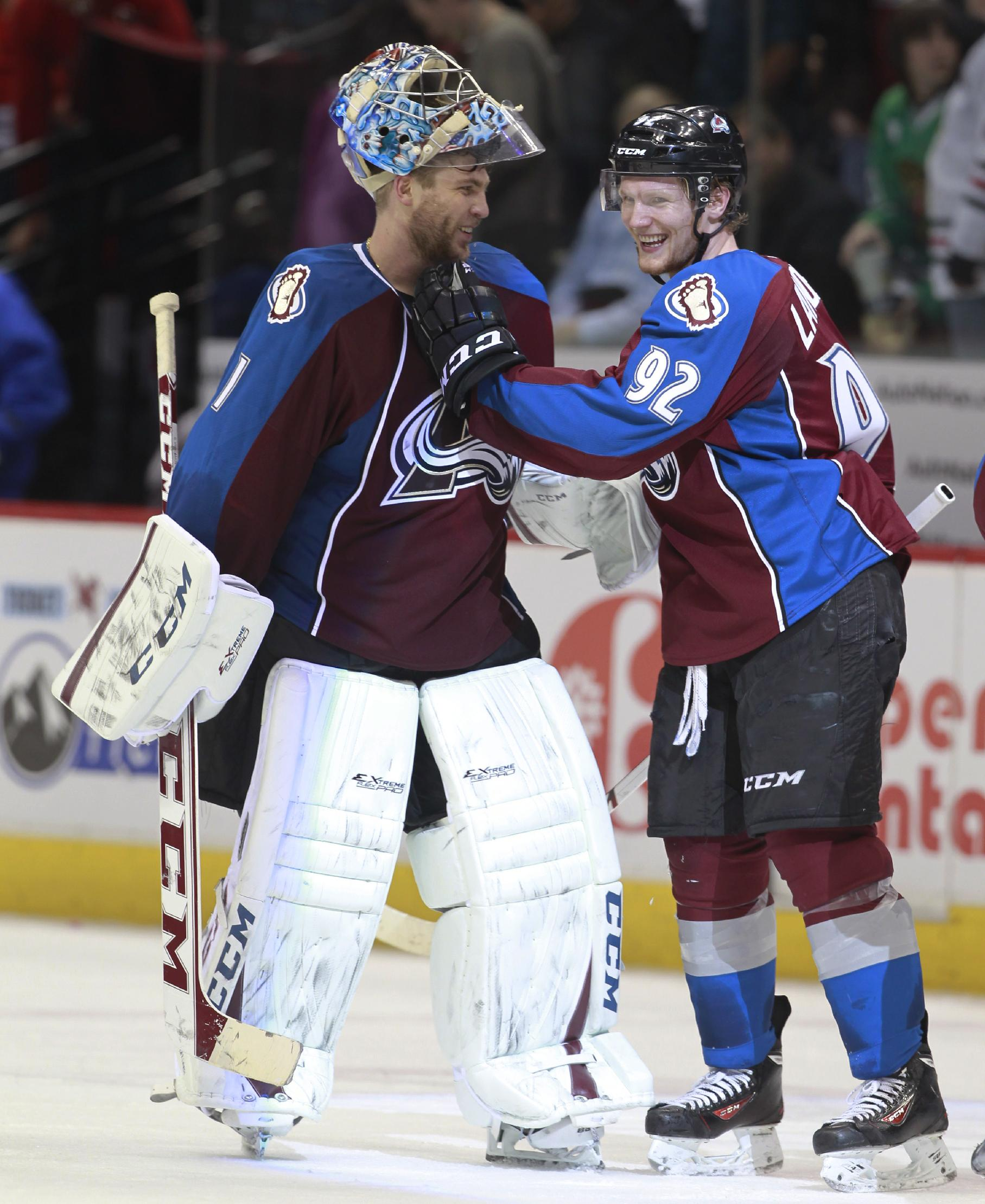 Colorado Avalanche goalie Semyon Varlamov, left, of Russia, celebrates with left wing Gabriel Landeskog, of Sweden, after the Avalanche's 3-2 victory over the Chicago Blackhawks in an NHL hockey game in Denver on Wednesday, March 12, 2014