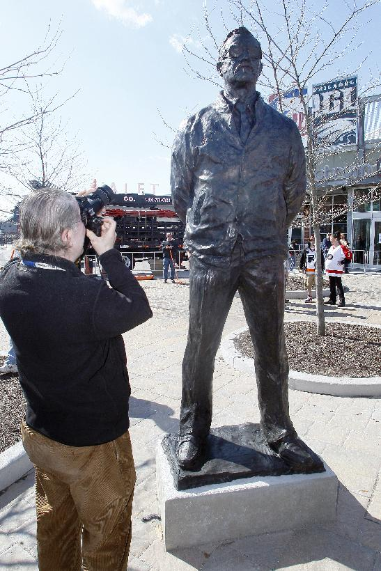 A photographer takes a photo of a statue honoring the late Philadelphia Flyers' head coach Fred Shero that was unveiled during a ceremony, Saturday, March 15, 2014, in Philadelphia