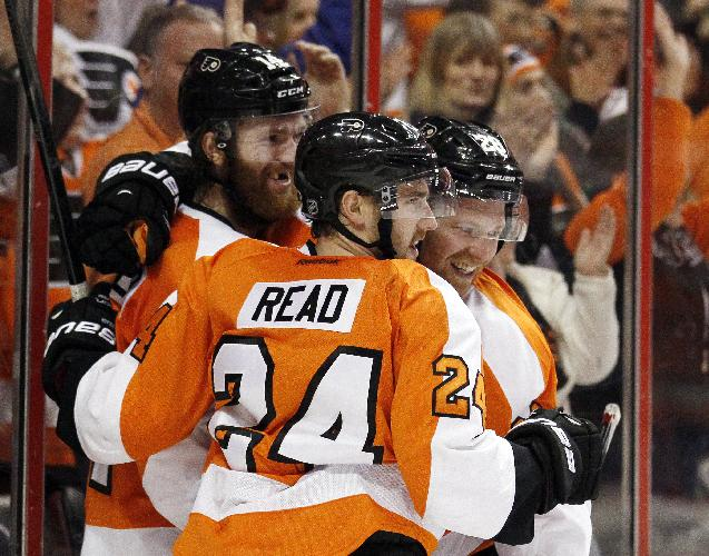 Philadelphia Flyers' Mattt Read, center, celebrates his goal along with teammates Sean Couturier, left, and Claude Giroux  during the second period of an NHL hockey game against against the Pittsburgh Penguins, Saturday, March 15, 2014, in Philadelphia