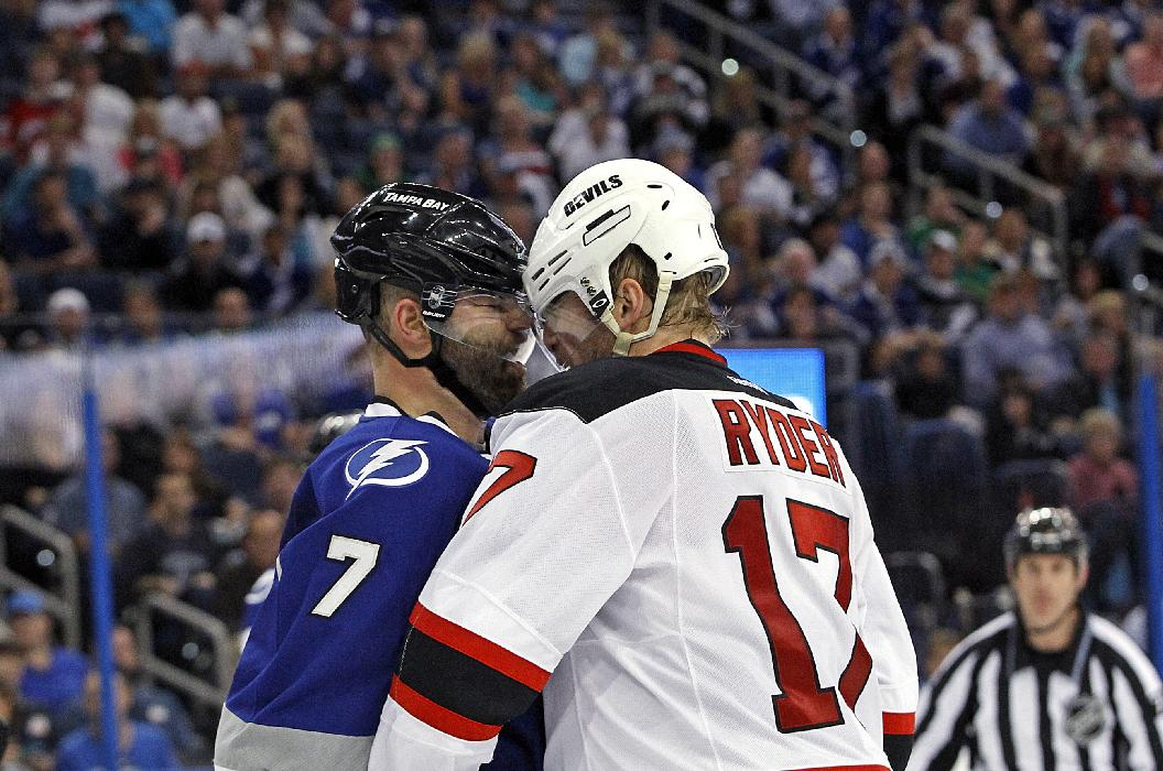 Tampa Bay Lightning defenseman Radko Gudas (7), of the Czech Republic, and New Jersey Devils right wing Michael Ryder (17) square off during the third period of an NHL hockey game Saturday, March 15, 2014, in Tampa, Fla. The Lightning won 3-0