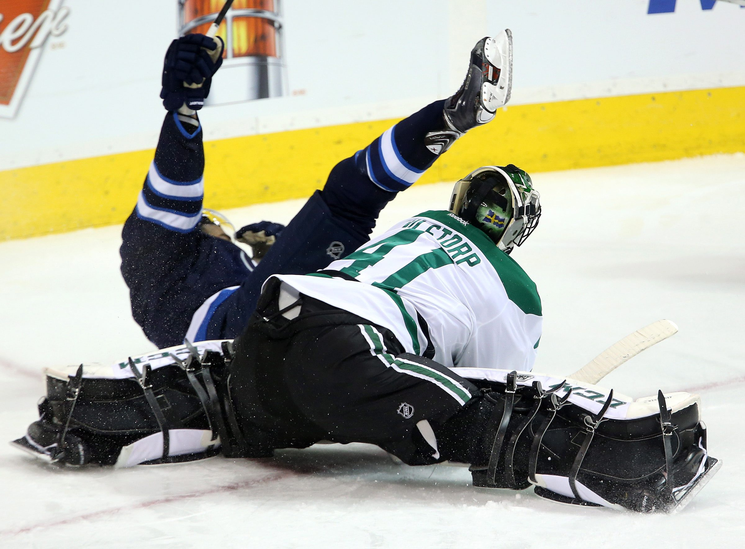 Winnipeg Jets' Evander Kane (9) celebrates his goal while crashing to the ice after beating Dallas Stars' Cristopher Nilstorp (41) during third period NHL hockey action at MTS Centre in Winnipeg, Manitoba, Sunday, March 16, 2014