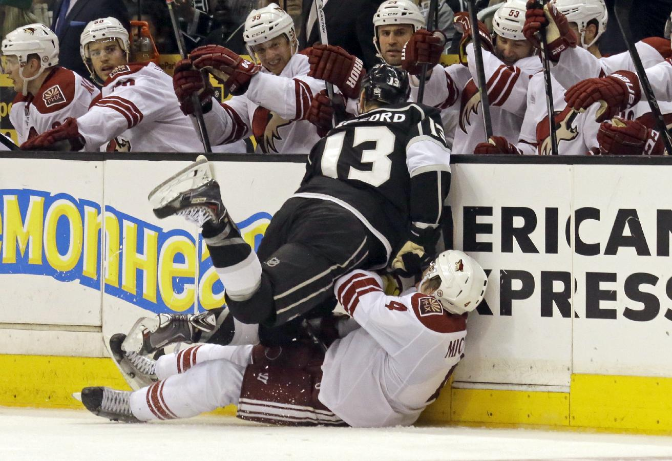 Phoenix Coyotes defenseman Zbynek Michalek (4), of the Czech Republic, and Los Angeles Kings left winger Kyle Clifford (13) collide in the second period of an NHL hockey game in Los Angeles Monday, March 17, 2014. The Coyotes won, 4-3