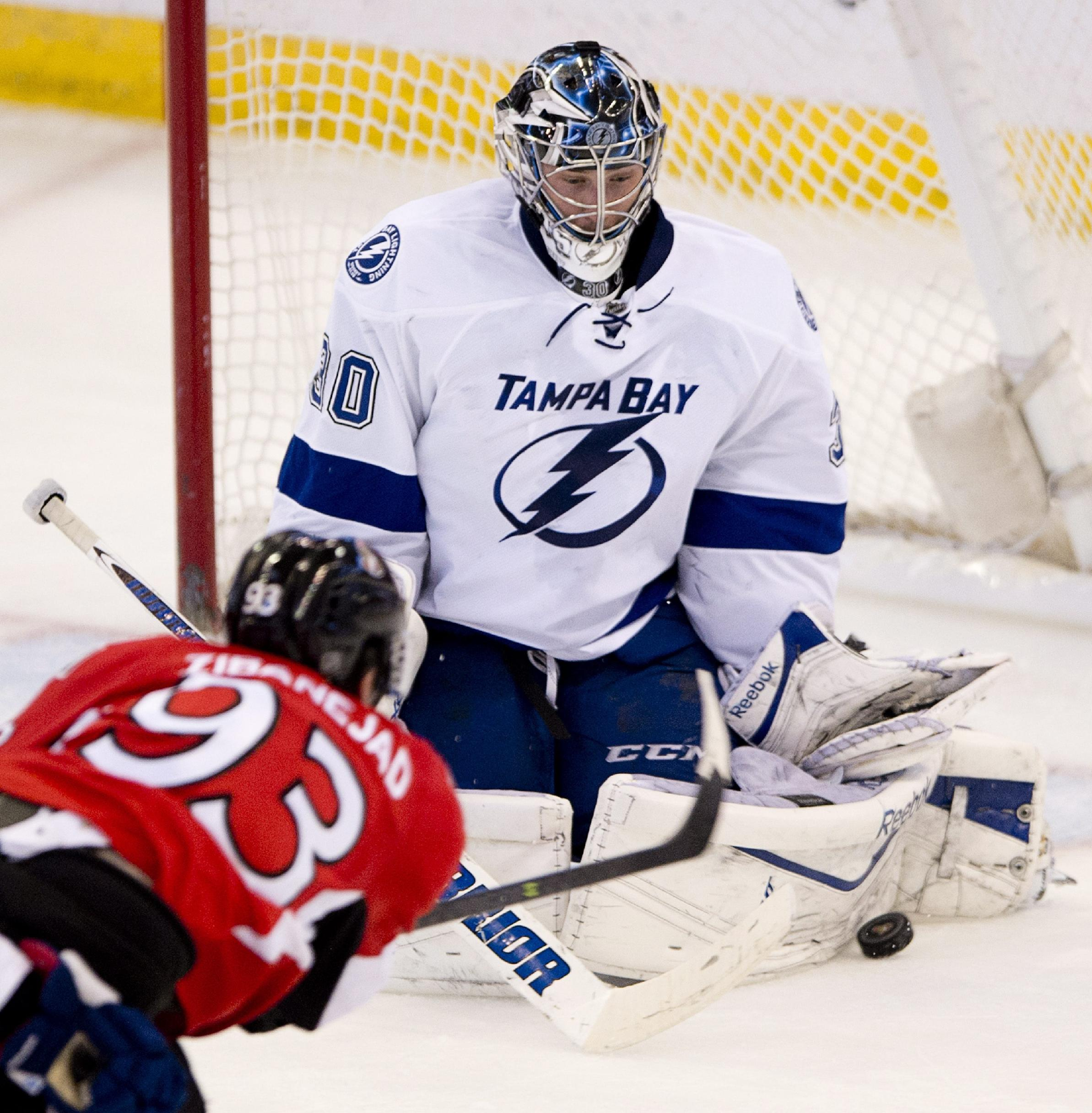 Ottawa Senators center Mika Zibanejad fires the puck on Tampa Bay Lightning goalie Ben Bishop uring the second period of an NHL hockey game Thursday, March 20, 2014, in Ottawa, Ontario