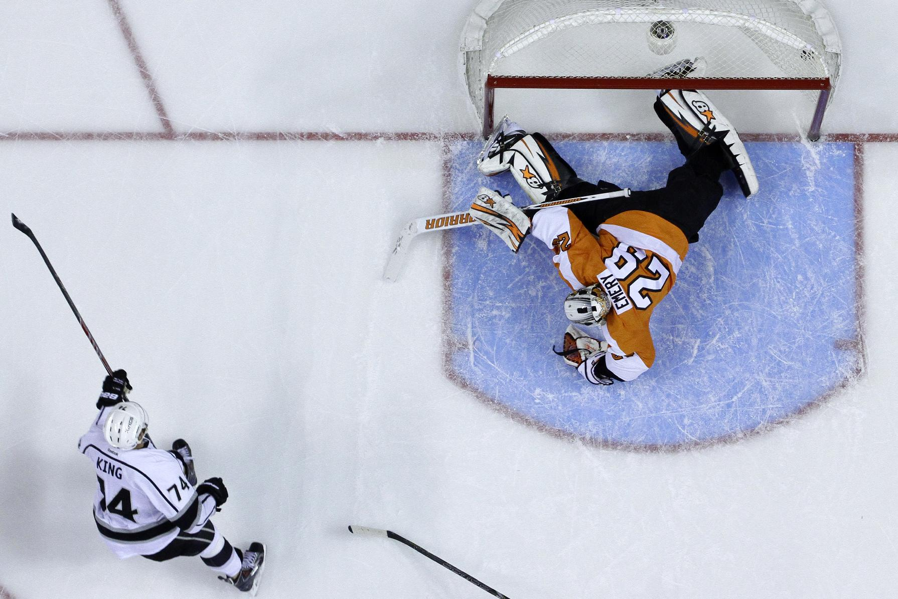 Philadelphia Flyers' Ray Emery, right, cannot block a goal by Los Angeles Kings' Dwight King during the third period of an NHL hockey game, Monday, March 24, 2014, in Philadelphia. Los Angeles won 3-2