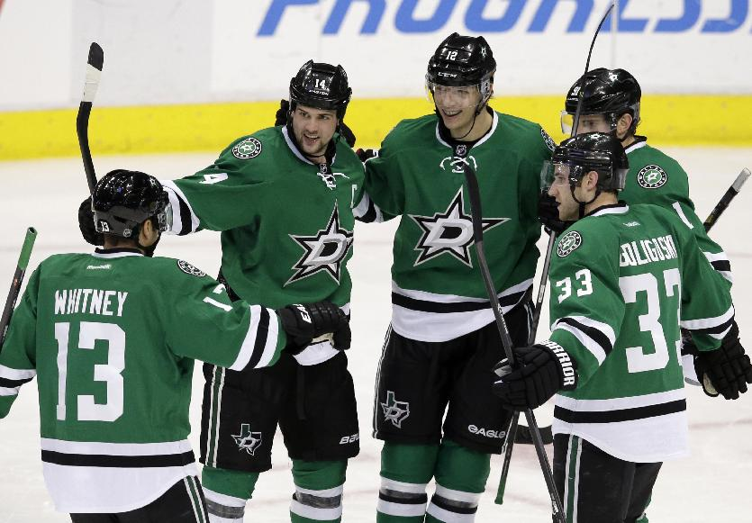 Dallas Stars' Ray Whitney (13), Jamie Benn, Alex Goligoski (33) and Tyler Seguin (91) celebrate with Alex Chiasson (12) following Chiasson's goal in the second period of an NHL hockey game against the Nashville Predators, Friday, March 28, 2014, in Dallas