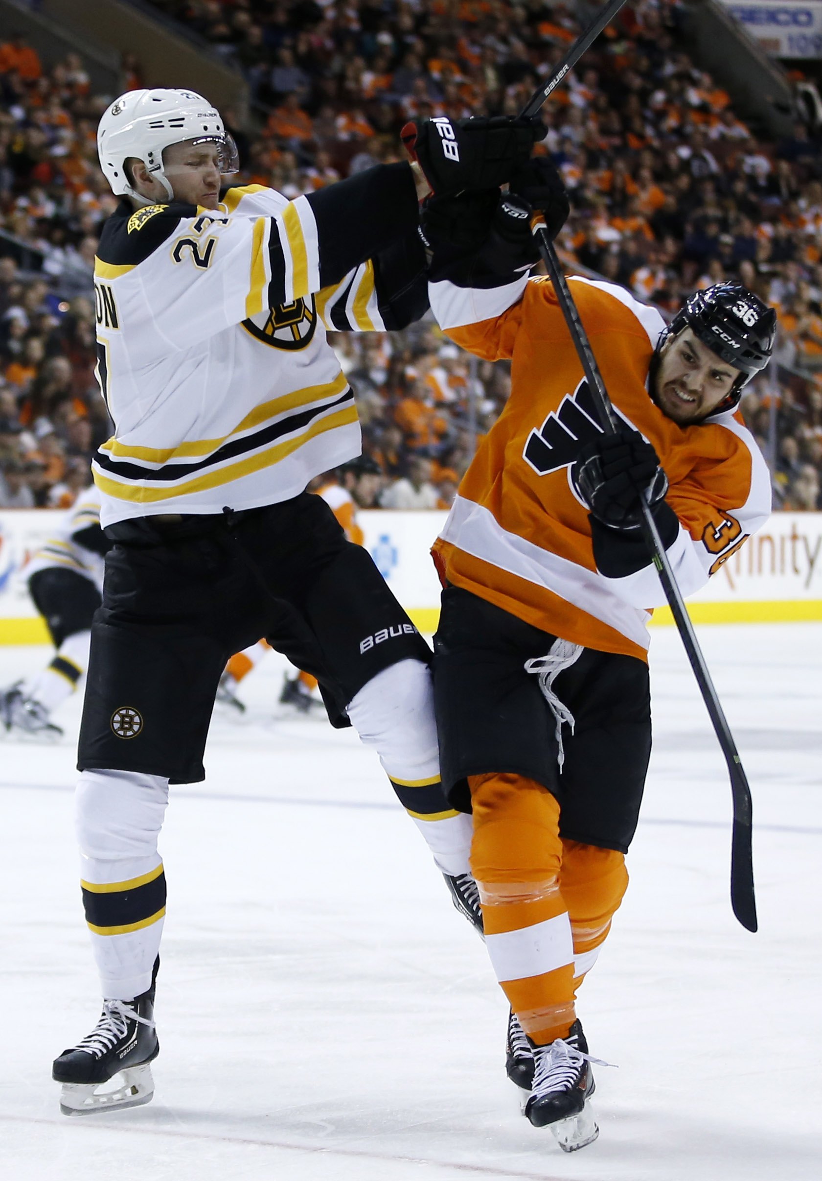 Boston Bruins' Dougie Hamilton, left, and Philadelphia Flyers' Zac Rinaldo collide during the second period of an NHL hockey game on Sunday, March 30, 2014, in Philadelphia