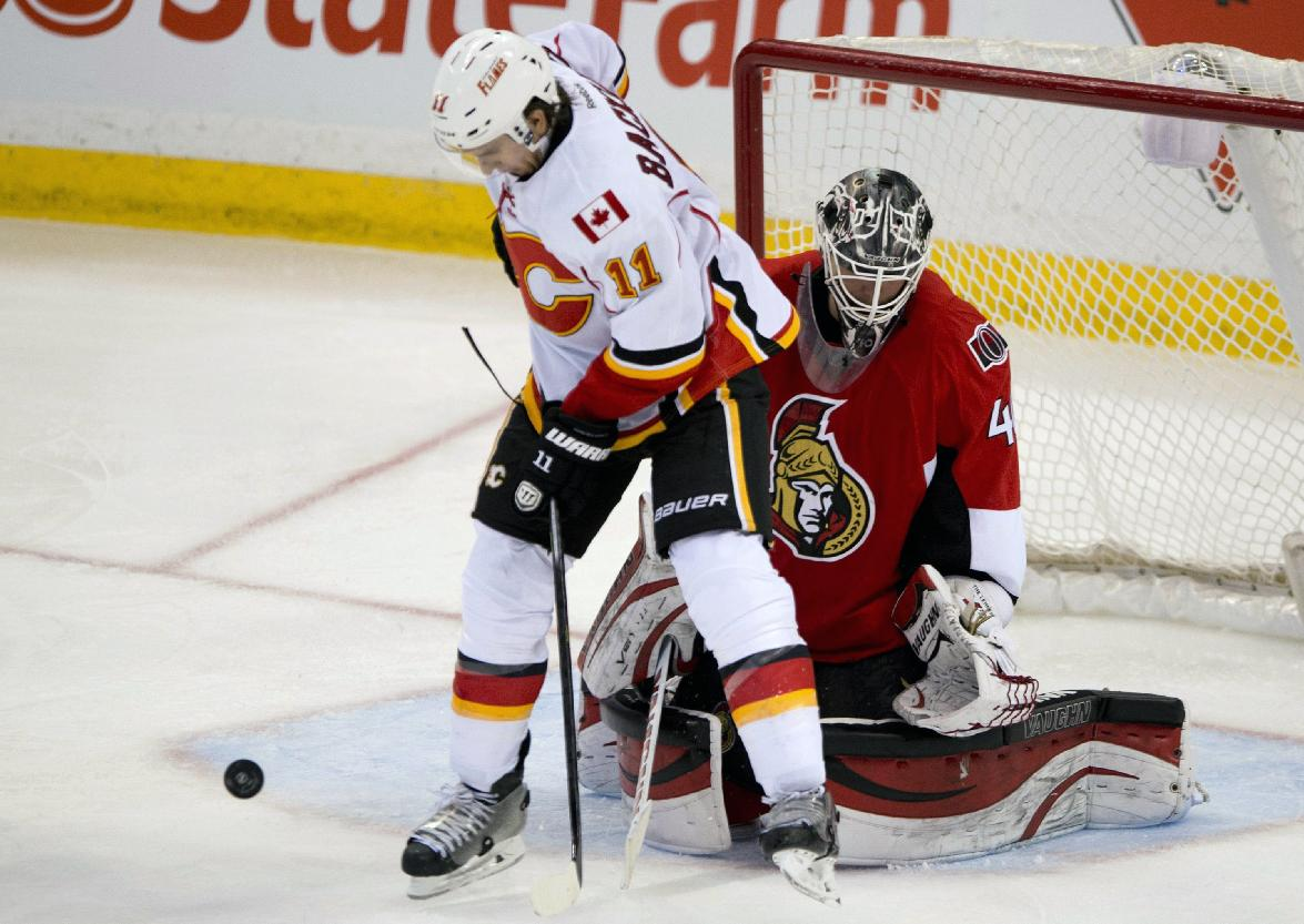 Calgary Flames center Mikael Backlund jumps in front of Ottawa Senators goalie Robin Lehner duringthe third period of an NHL hockey game, Sunday, March 30, 2014, in Ottawa. Lehner had 37 saves as the Senators defeated the Flames 6-3