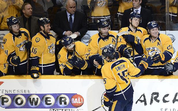 Nashville Predators forward Craig Smith (15) celebrates with his teammates after scoring a goal during a shootout at an NHL hockey game against the Washington Capitals on Sunday, March 30, 2014, in Nashville, Tenn. The Predators won the shootout to win the game 4-3
