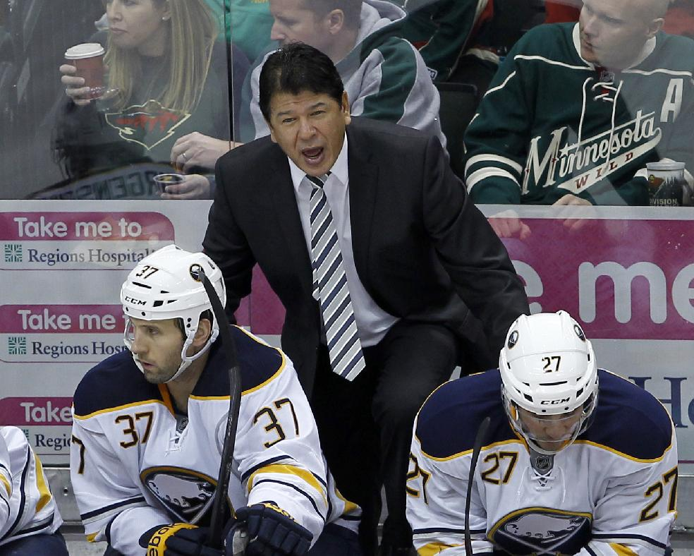 In this Jan. 2, 2014 file photo, Buffalo Sabres interim head coach Ted Nolan disagrees with referee Darcy Burchell during the third period of an NHL hockey game against the Minnesota Wild in St. Paul, Minn.  Nolan will oversee the team's rebuilding plans beyond this season after signing a three-year contract extension on Monday, March 31, 2014. The team lifted Nolan's