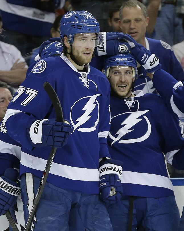 Tampa Bay Lightning right wing Ryan Callahan, right, celebrates his goal against the Montreal Canadiens with teammate Victor Hedman during the second period of an NHL hockey game Tuesday, April 1, 2014, in Tampa, Fla