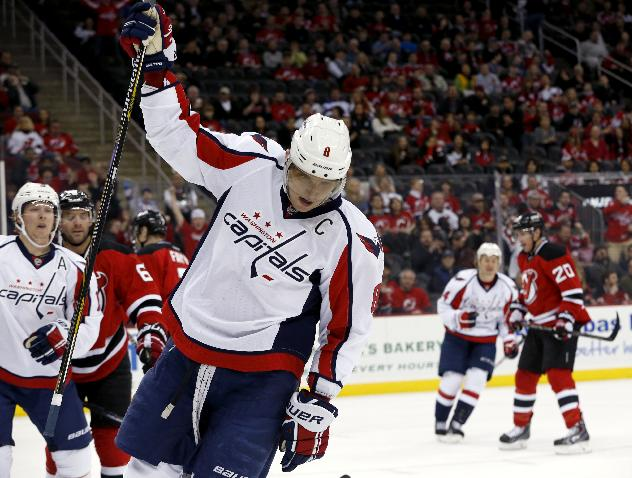 Washington Capitals right wing Alex Ovechkin, of Russia, celebrates after scoring a goal against the New Jersey Devils during the first period of an NHL hockey game, Friday, April 4, 2014, in Newark, N.J