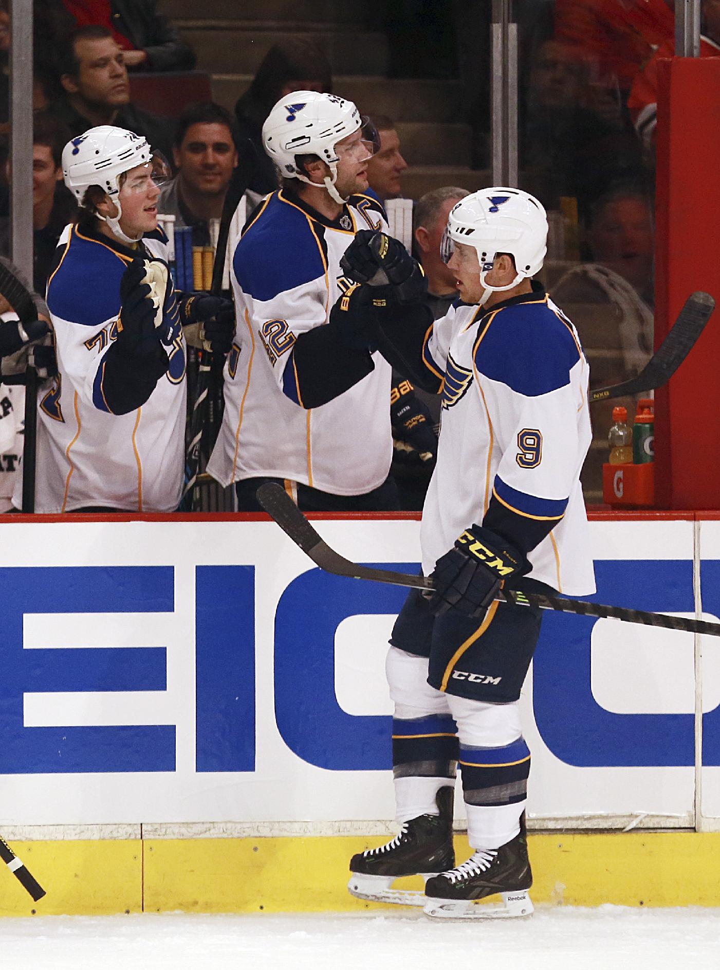 St Louis Blues' Jaden Schwartz, right, celebrates with teammates T.J. Oschie, left, and David Backes after scoring a first period goal against the Chicago Blackhawks in an NHL hockey game in Chicago on Sunday, April 6, 2014