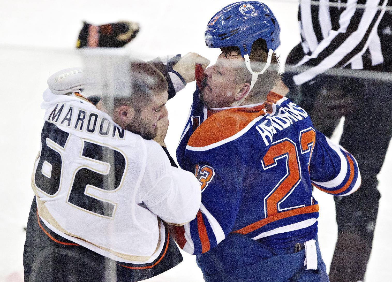 Anaheim Ducks Patrick Maroon (62) fights Edmonton Oilers Matt Hendricks (23) during second period NHL hockey action in Edmonton,  Alberta, on Sunday April 6, 2014