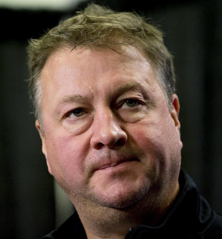 In this Jan. 13, 2013 file photo, Vancouver Canucks general manager Mike Gillis holds a news conference during the first day of the NHL hockey team's training camp in Vancouver, British Columbia. The Canucks have fired Gillis, Tuesday, April 8, 2014,  a day after being eliminated from playoff contention