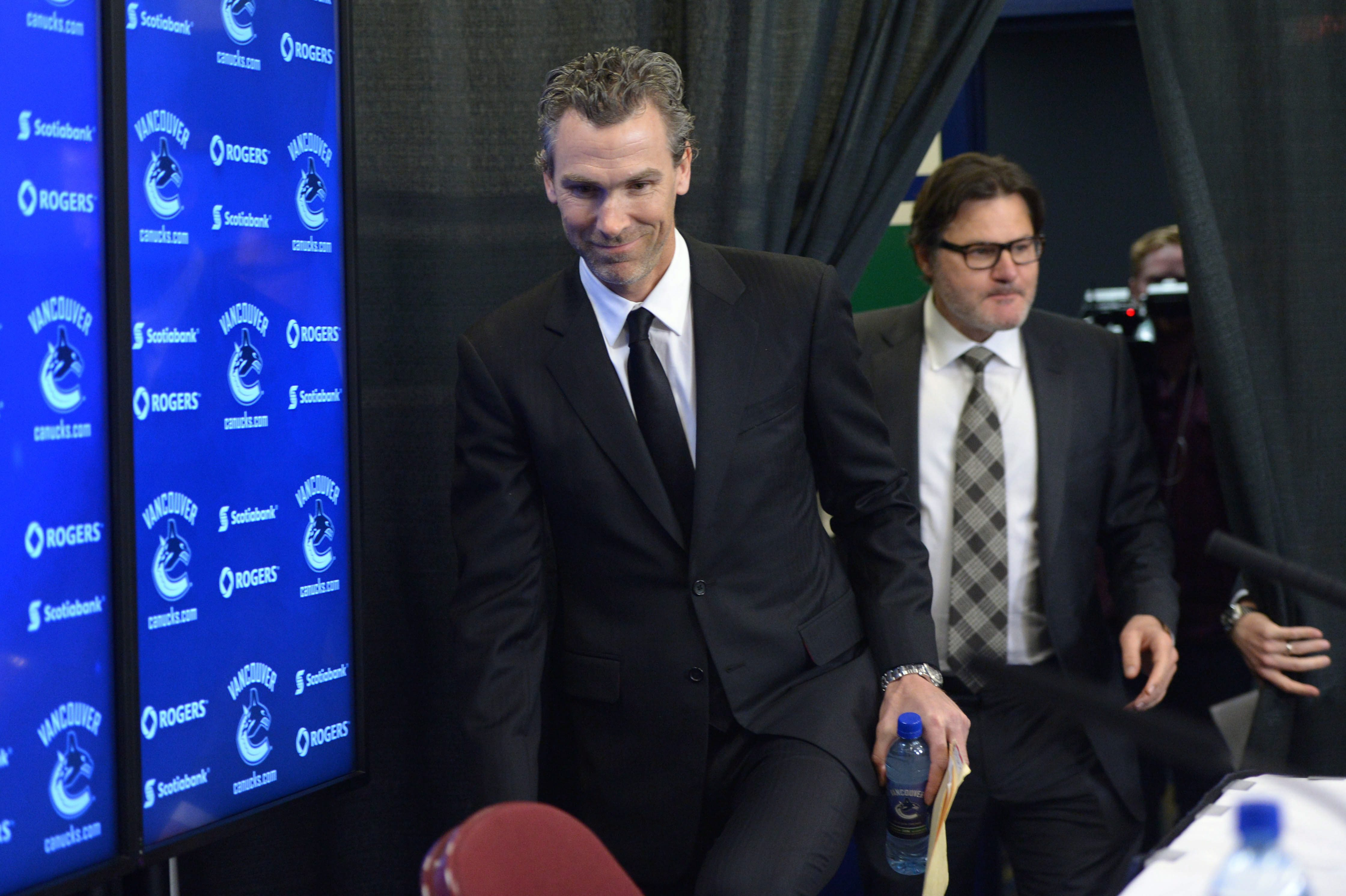 Former Vancouver Canucks captain Trevor Linden arrives for a press conference followed by team owner Francesco Aquilini in Vancouver on Wednesday, April 9, 2014. Linden has been hired as Vancouver's president of hockey operations