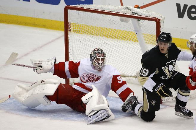 Detroit Red Wings goalie Jonas Gustavsson (50) gets up after colliding with Pittsburgh Penguins' Beau Bennett (19) during the first period of an NHL hockey game in Pittsburgh, Wednesday, April 9, 2014