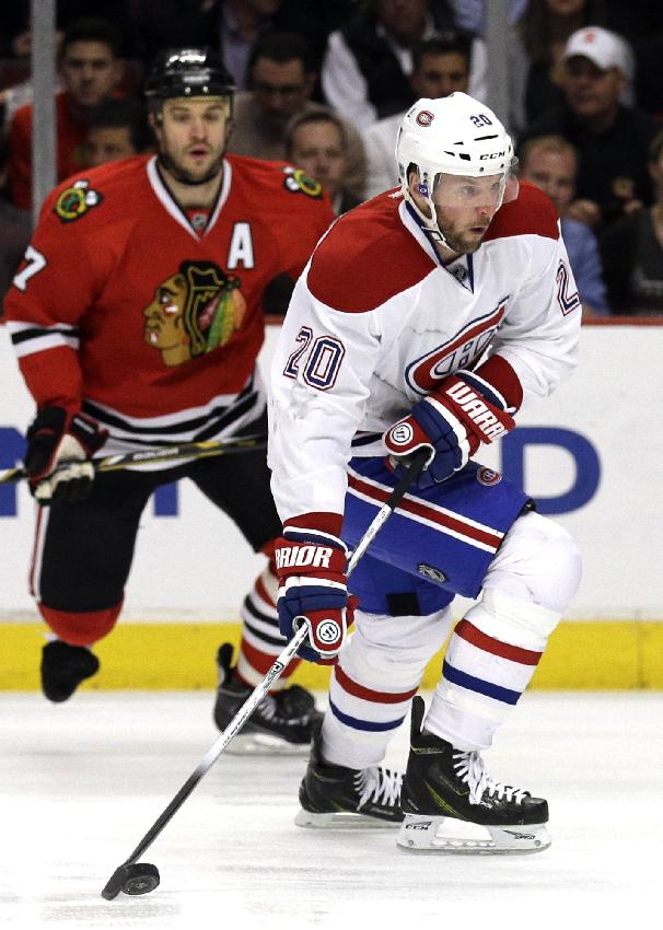 Montreal Canadiens' Thomas Vanek (20) looks to a pass during the first period of an NHL hockey game against the Chicago Blackhawks in Chicago, Wednesday, April 9, 2014