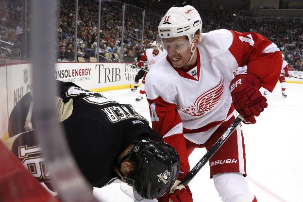 Detroit Red Wings' Daniel Alfredsson (11) works against Pittsburgh Penguins' Brandon Sutter (16) along the boards during the second period of an NHL hockey game in Pittsburgh, Wednesday, April 9, 2014
