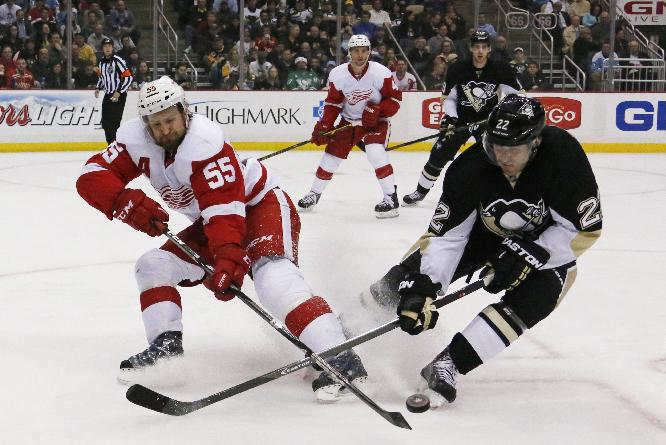 Detroit Red Wings' Niklas Kronwall (55) clears the puck before Pittsburgh Penguins' Lee Stempniak (22) can get his stick on it during the second period of an NHL hockey game in Pittsburgh, Wednesday, April 9, 2014