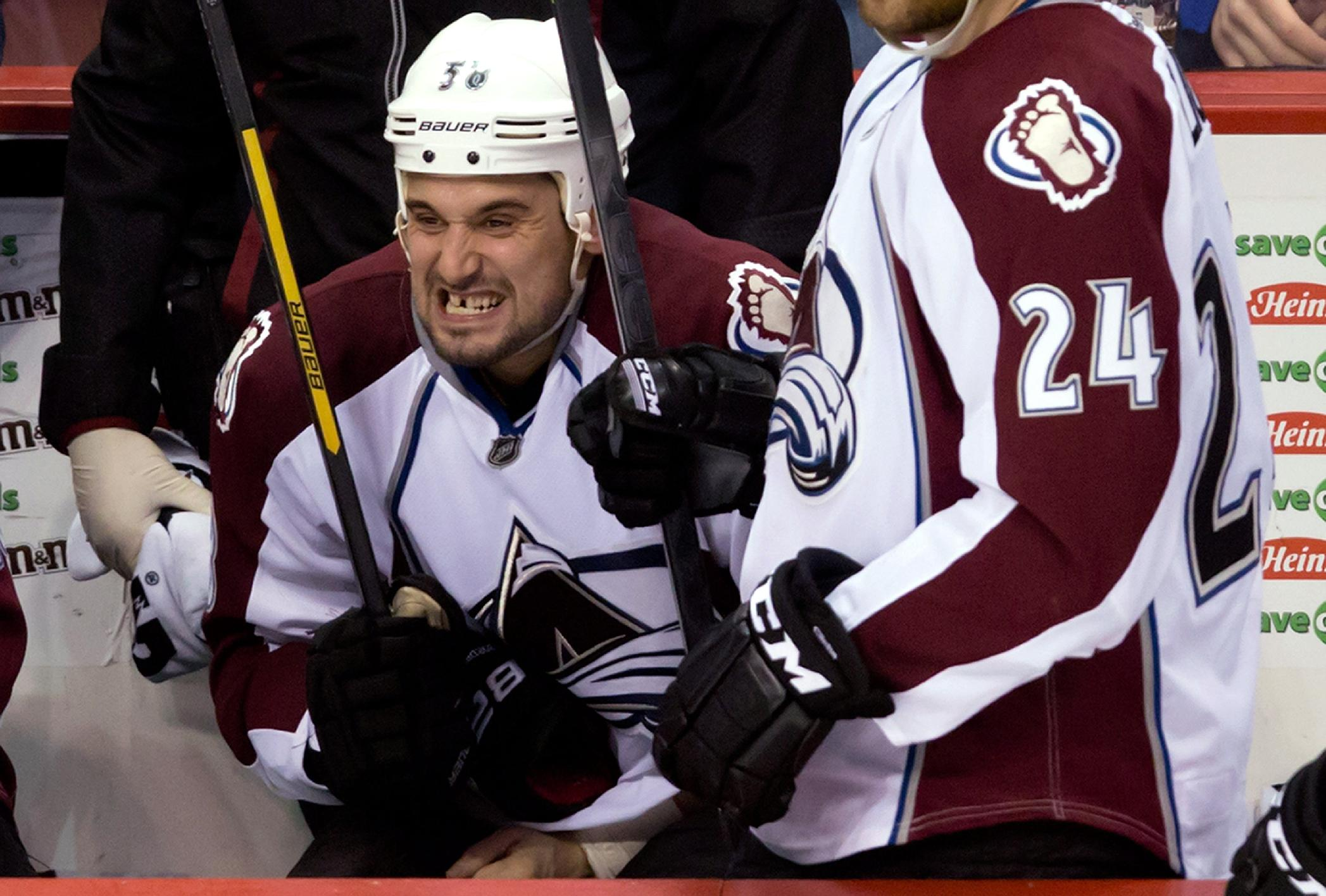 Colorado Avalanche's Patrick Bordeleau reacts on the bench after getting slashed during the third period of an NHL hockey game against the Vancouver Canucks on Thursday, April 10, 2014, in Vancouver, British Columbia