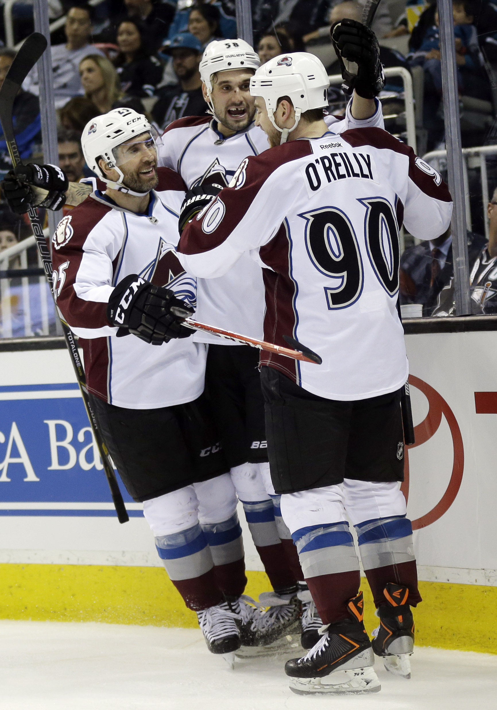 Colorado Avalanche's Patrick Bordeleau, center, celebrates his goal with teammates Ryan O'Reilly (90) and Maxime Talbot, left, during the second period of an NHL hockey game against the San Jose Sharks on Friday, April 11, 2014, in San Jose, Calif