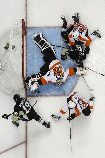 Pittsburgh Penguins' Beau Bennett (19) can't get a shot past Philadelphia Flyers goalie Steve Mason (35) in the second period of an NHL hockey game in Pittsburgh, Saturday, April 12, 2014. The Flyers won 4-3 in overtime