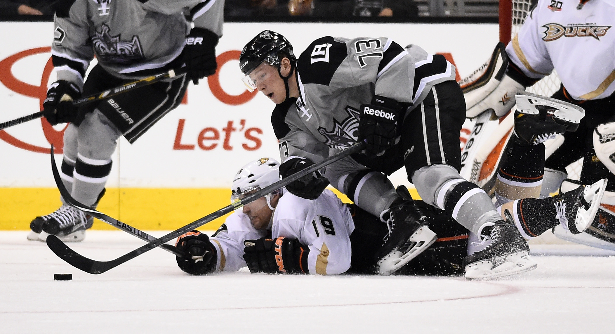 Anaheim Ducks defenseman Stephane Robidas, below, and Los Angeles Kings center Tyler Toffoli battle for the puck during the third period of an NHL hockey game, Saturday, April 12, 2014, in Los Angeles