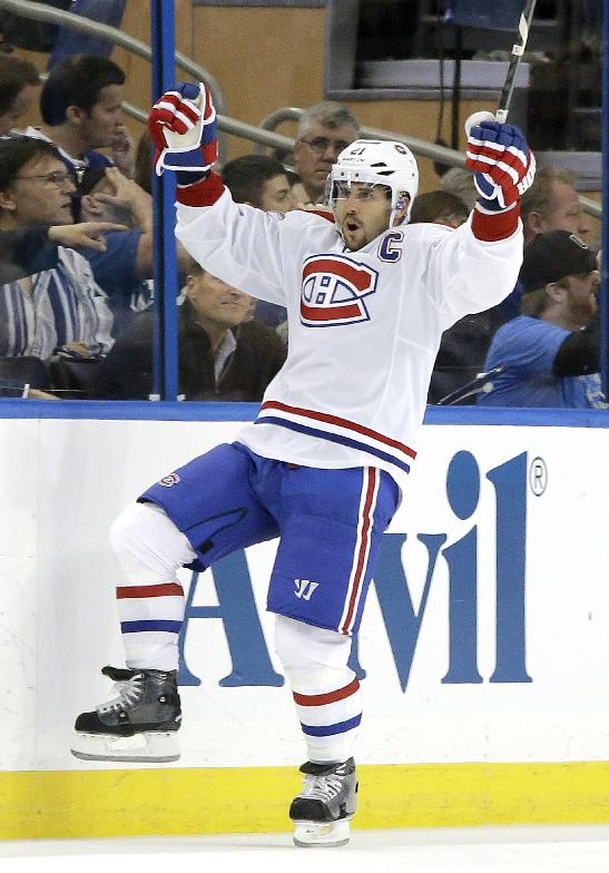 Montreal Canadiens right wing Brian Gionta celebrates after his short-handed goal against the Tampa Bay Lightning during the second period of Game 1 of a first-round NHL hockey playoff series on Wednesday, April 16, 2014, in Tampa, Fla