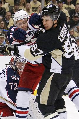 Columbus Blue Jackets' Jack Johnson (7) tries to clear Pittsburgh Penguins' Sidney Crosby (87) from in front of Blue Jackets goalie Sergei Bobrovsky (72) during the second period of a first-round NHL playoff hockey game in Pittsburgh on Wednesday, April 16, 2014